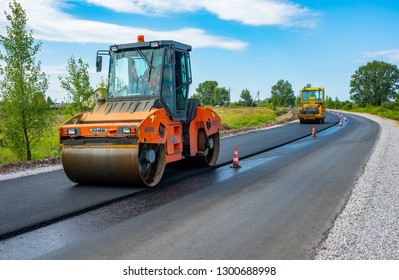 Reconstruction of the highway, Tyumen, Russia: July 31, 2018. Roller compacts asphalt on road during the construction of the road. compaction of the pavement in road repairs