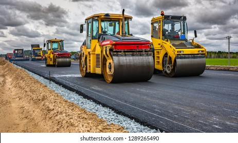 Reconstruction of the highway, Tyumen, Russia: May 28, 2018. Roller compacts asphalt on road during the construction of the road. compaction of the pavement in road construction. rink goes on fresh
