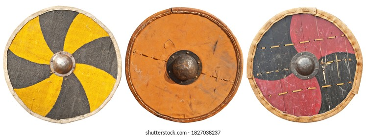 Reconstruction of an old medieval shield. Replica Viking weapon. round shield isolated on a white background.