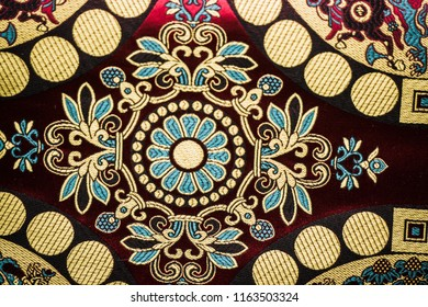 Reconstruction of traditional medieval jacquard patterns. Golden brocaded decorative design on red background. Traditional, popular medieval ornaments. Celtic, Renaissance and Medieval Jacquard