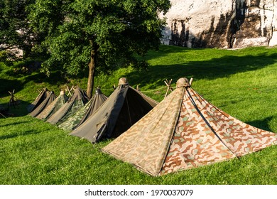 Reconstruction of a World War II military camp during a reenactment event.  German military tents from World War II.