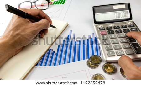 record expenses on note book business financial stock photo edit