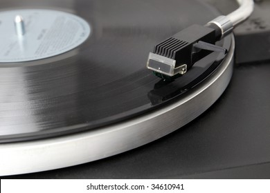 A record player is playing an album