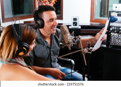 Record producer showing young singer the right way to perform the song