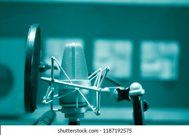 Recording audio studio microphone to record audio of voice, singing and voiceover actors.