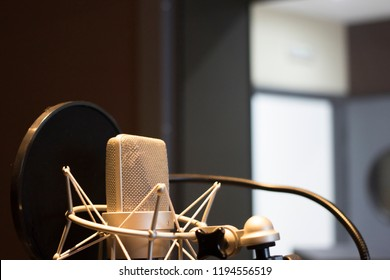 Recording audio studio microphone to record audio of voice, singing and voiceover actors.