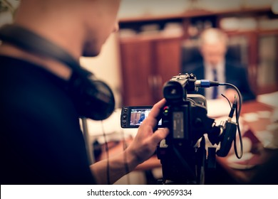 Recording interview with politician using professional camera. - vintage filter