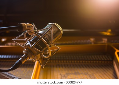 Recording microphone above grand piano