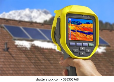 Recording Photovoltaic Solar Panels on the roof House With Thermal Camera
