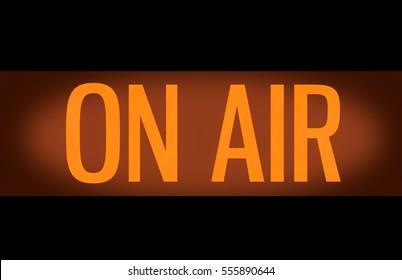 Recording Or Radio Studio Glowing Orange On Air Sign