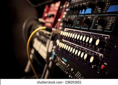 recording studio gears in rack, focus on knob & shallow dept of field