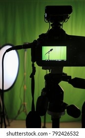 recording studio with green background and cameras and microphones