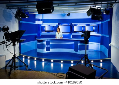 recording at TV studio with television anchorwoman