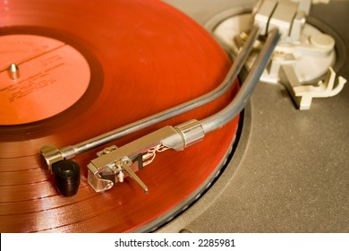 recordplayer with red lp records (33 1/3 rpm)