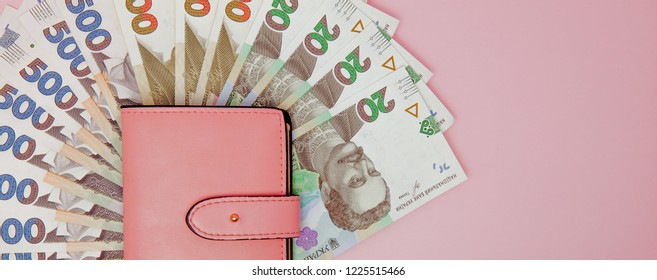 recount money ukrainian hryvnia bills in wallet. Finance crisis in Ukraine, the fall of the hryvnia to the dollar exchange rate.