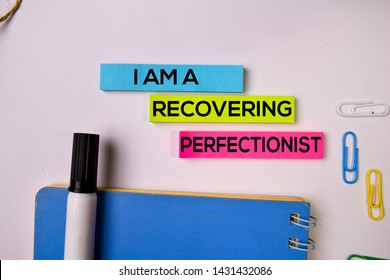 I am A Recovering Perfectionist on sticky notes isolated on white background.
