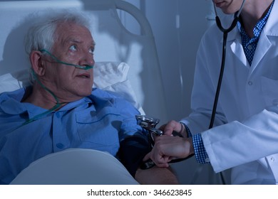 Recovering senior patient examined by doctor in hospital