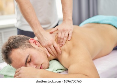 Recovery massage of an athlete after competitions, training. Professional sports massage.