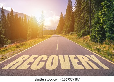 Recovery word written on road in the mountains