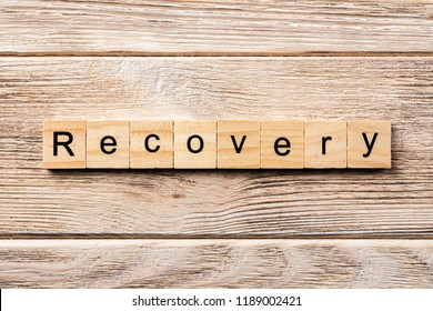 recovery word written on wood block. recovery text on table, concept.