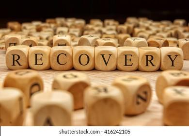 Recovery word written on wood block