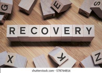 Recovery Word Written In Wooden Cube
