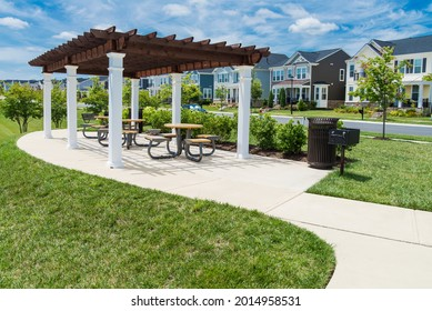 recreation area with pergola and barbecue in a residential area. flowers and green lawn under the blue sky. - Shutterstock ID 2014958531