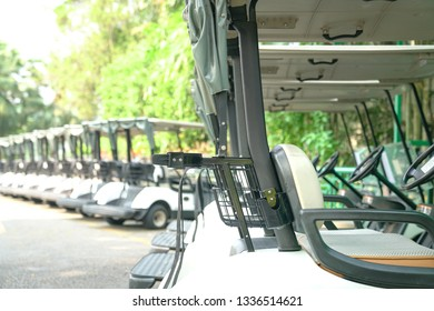 Recreation or transport concept : Golf carts parked outside a golf club