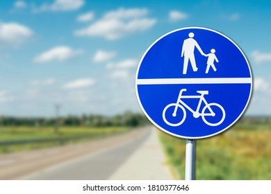 Recreation walk and cycle path road sign. Round blue information sign. Ubran area road safe to walk.