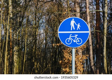 Recreation walk and cycle path road sign. Round blue information sign. Ubran area road safe to walk. Forest cycle road. Walking path route sign.