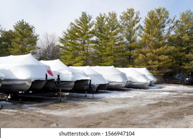 Recreational boats shrink wrapped for the winter at the marina on Fox River