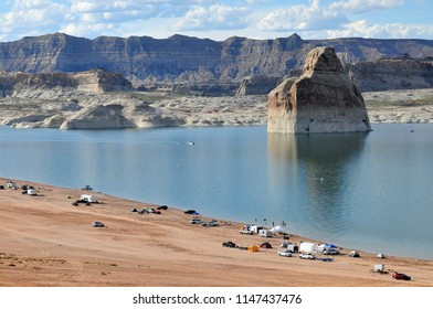Recreational campers enjoy beach camping next to Lake Powell in Utah.