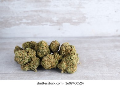 Recreational marijuana on a white stone background after Illinois passes a law to legalize weed sales and pardon weed related prisoners. Flower trichomes and kief made beautiful during plant curing