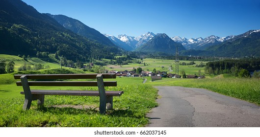 recreational place with bench above rubi village, view to oberstdorf and allgau alps