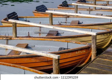 Recreational rowboats moored at lake Schlachtensee in Berlin-Zehlendorf, Germany.