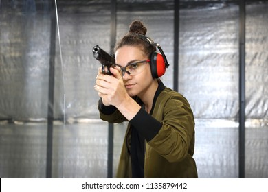 Recreational shooting at the shooting range. A woman at the shooting range.