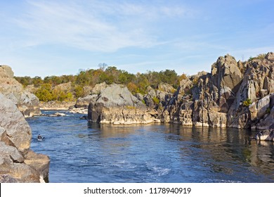 Recreational sport activities at a scenic river turns in Great Falls park, Virginia, USA. Mountainous riverbanks and rapids on Potomac River in autumn.