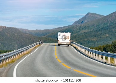 Recreational vehicle on mountain road in Norway, Europe. Car travel through scandinavia. Blue sky and mountains in background.