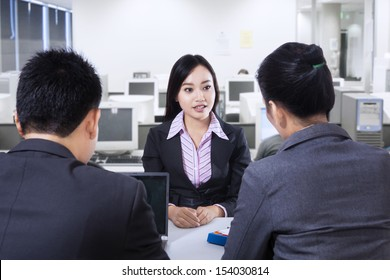 Recruiter checking the candidate during job interview at office