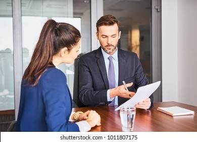 Recruiter conducting business job interview with female applicant in office