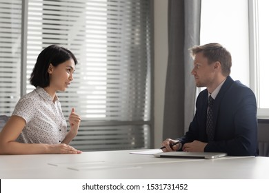 Recruiter listening to young Asian candidate at job interview, confident applicant answering to recruiter questions, introduction, good first impression, recruitment process, human resources