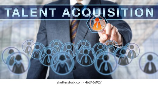 Recruiter is pushing TALENT ACQUISITION on an interactive virtual display. Business concept involving temporary or permanent employment, recruitment challenges and human resource management.