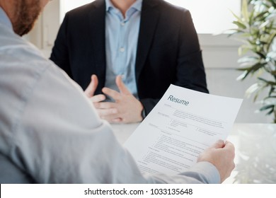 Recruiter reading curriculum of a candidate for a job