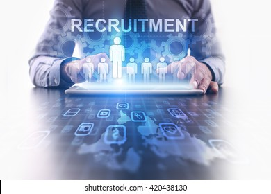 Recruitment concept. Businessman using futuristic tablet computer, pressing button on the touch screen and selecting Recruitment.