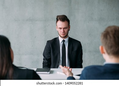 Recruitment and employment. Young man failed job interview. Ashamed facial expression. Copy space.