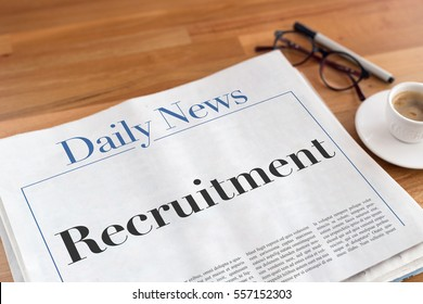 Recruitment headlined newspaper on the table