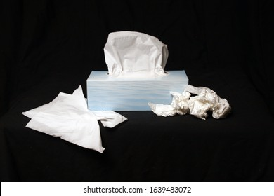 rectangle blue box of tissues on black background