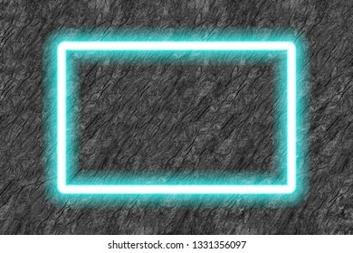 rectangle blue neon tube frame on black stone background.