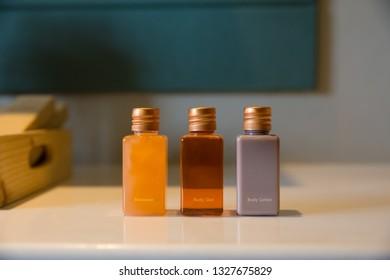 rectangle bottles of amenity set in bathroom