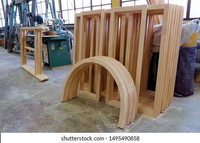 Rectangular and arched glued parts of wooden pine windows